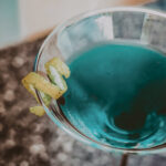 Blue cocktail mixed in Headwaters Lounge & Patio at Millcroft Inn & Spa in Caledon