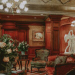 Prince of Wales Victorian-style Hotel lobby with classical artwork and fresh roses