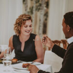 Couple sharing a romantic dinner at Noble Restaurant at the Prince of Wales Hotel
