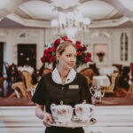 Ornate tea sets and regal decor located in the Drawing Room at the Prince of Wales Hotel