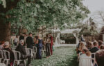 Family and friends gather at the Courtyard Rose Garden wedding venue at the Pillar & Post in Niagara-on-the-Lake