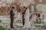 Couple getting married at the Courtyard Rose Garden wedding venue during spring at the Pillar & Post in Niagara-on-the-Lake