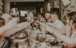 Wedding party rejoices in the River Room wedding venue at Millcroft Inn & Spa in Caledon
