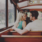 Couple aboard the Vintage Hotels Trolley going on a wine tour