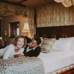 couple in bed in the royal suite at prince of wales hotel