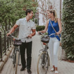 Couple using bike rental services at Inn On The Twenty in Jordan Village