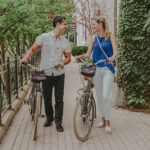 Couple indulging in bike rental services at Inn On The Twenty in Jordan Village