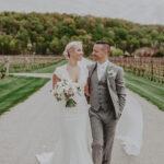 Newlyweds explore vineyard wedding venue at Inn On The Twenty in Jordan Village