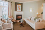 Signature Guest Suite seating area with fireplace at Inn On The Twenty in Jordan Village