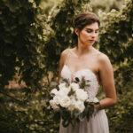 Bride in garden on wedding day at Inn On The Twenty in Jordan Village