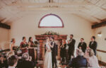 Couple gets married with family and friends at Cave Spring Vineyard at Inn On The Twenty in Jordan Village