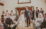 Couple takes first steps as married couple at Cave Spring Vineyard at Inn On The Twenty in Jordan Village