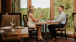 Couple sharing a romantic meal at Headwaters Restaurant at Millcroft Inn & Spa in Caledon