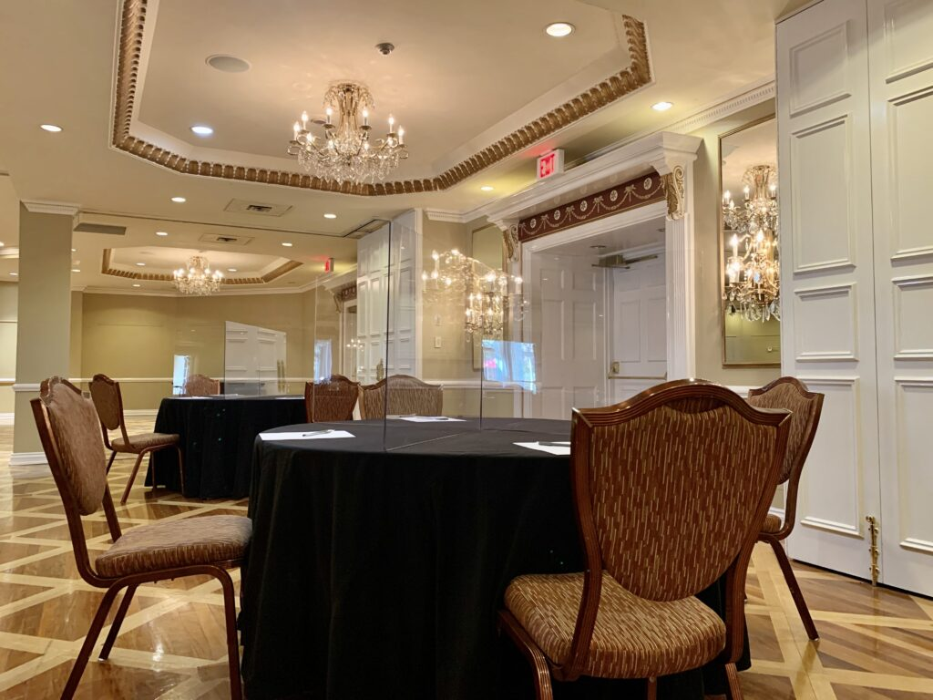 safe meeting set up with plexiglass at Queen's Landing Hotel
