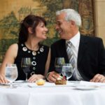 Couple dining at Noble restaurant, Prince of Wales on the Snowbird package