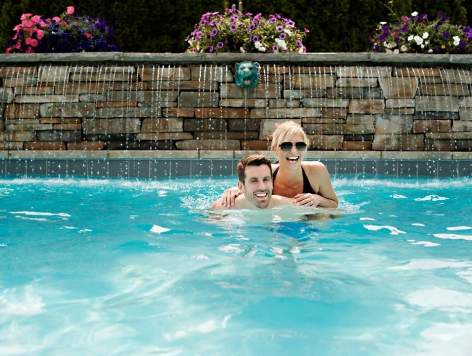 Couple enjoy a pool experience at Pillar and post