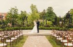 La Roserie wedding venue aisle view with bride and groom at Pillar & Post Hotel in Niagara-on-the-Lake
