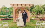 Couple takes their first steps as husband and wife at Le Petit Pavilion wedding venue at Pillar & Post Hotel in Niagara-on-the-Lake