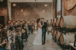 newly married couple dancing in the barrel room at the hare wine co in niagara on the lake